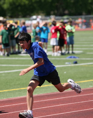A Fort Worth Student running after participating in the Run Like a Cheetah program